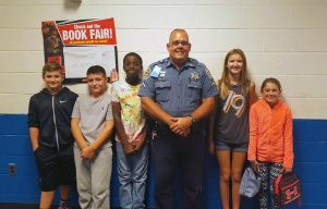 Dfc. Ron Hardy posing with 6th graders.