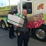 Pictures of first responders delivering gifts to Williamsport families