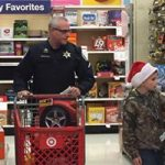 Pictures of local children shopping with deputies